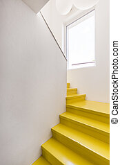 Yellow staircase in minimalist house