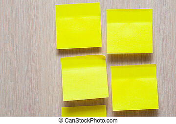 yellow stickers on a wooden background