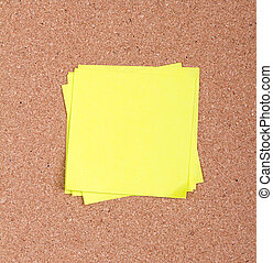 sticky note on a bulletin board