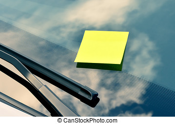 Yellow Sticky Note on a Windshield