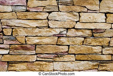 Yellow stone wall