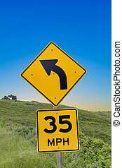 street sigh 35 MPH at Cabrillo highway with sign winding ...