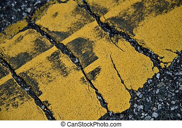 Yellow stripe on asphalt - A close up of yellow painted line...