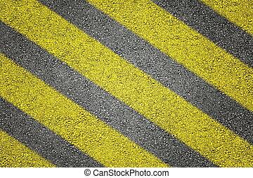 Yellow stripes on asphalt