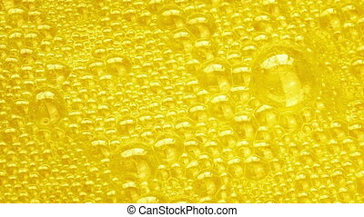 Yellow substance with bubbles rising up and popping on the surface