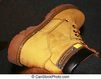 Yellow suede boots on the mans foot