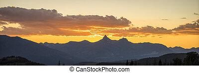 Yellow sunset above pilot peak, Yellowstone National Park