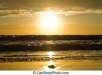 Yellow sunset over the sea