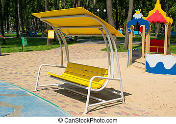 Yellow swing in the park