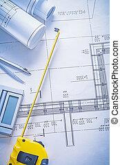 yellow tapeline calculator compass rolls of blueprints