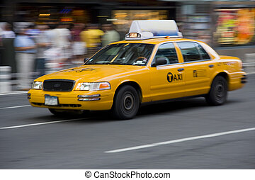 Yellow Taxi cab in motion - New York City yellow taxi cab in...