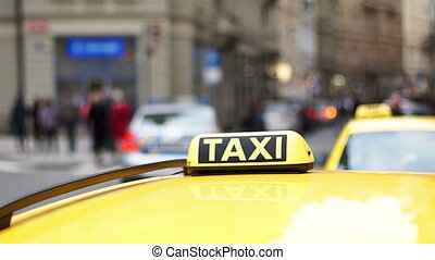 Yellow taxi car in the background of the street