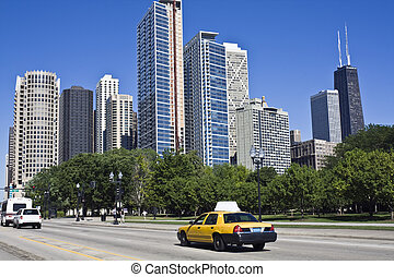 Yellow taxi in downtown Chicago, IL.