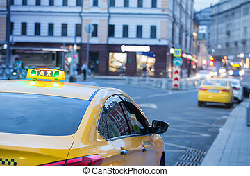 yellow taxi in the evening on the city