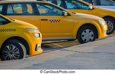 taxi in the parking lot - yellow taxi in the parking lot