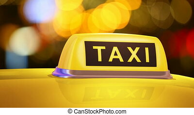 Yellow taxi sign on car - Macro view of yellow taxi sign on...