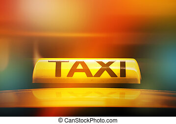 Taxi Sign on Car Rooftop, Street Light Bokeh