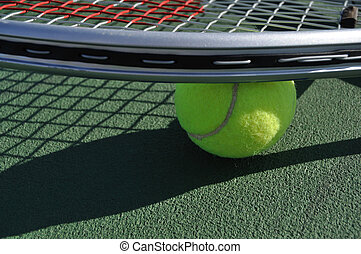 Yellow Tennis Ball and Racquet