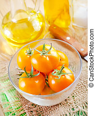 yellow tomato in the glass bowl