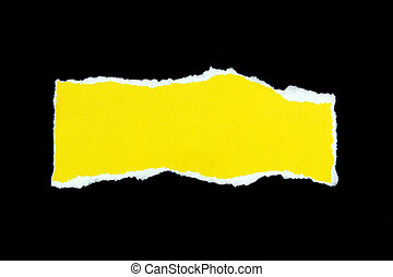 yellow torn paper on black background
