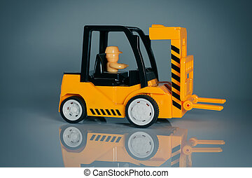 Yellow toy forklift. Small loader. Kids toys. Tous for childrens