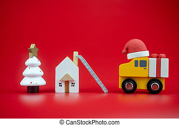 Yellow toy truck carry present sent to kid at home by santa claus.