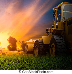 Yellow tractor in a field