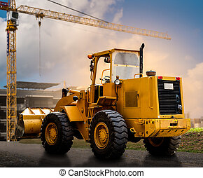 yellow tractor on the road