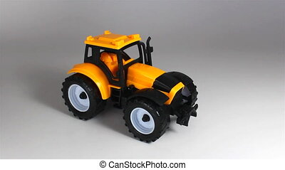Yellow tractor ride and stop in front on white background