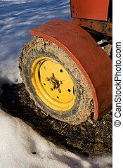 Yellow tractor wheel.