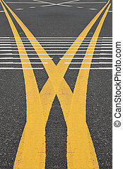 yellow traffic lines on the road.