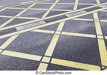 Yellow traffic sign on asphalt
