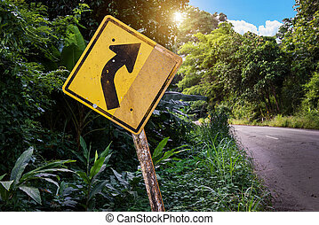 yellow traffic sign on the side or country side road