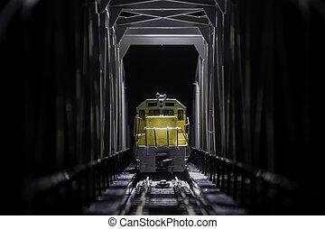 Yellow train on the bridge