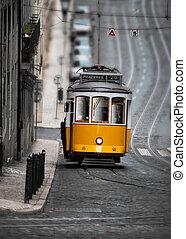 Yellow tram in street of Lisbon