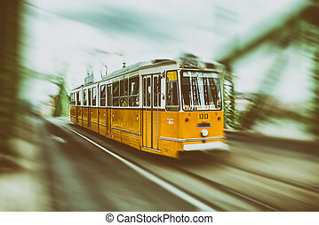 Yellow tram on Liberty bridge in Budapest, Hungary
