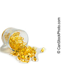 Yellow translucent pills in a glass Cup on a white background. Isolate. Omega, vitamins, food supplements.