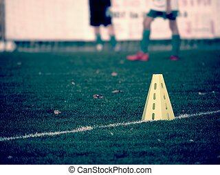 yellow triangles used as soccer training equipment