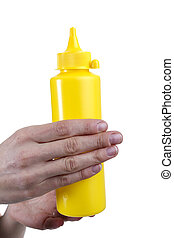 Yellow tube for sauces in female hands