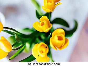 Yellow Tulip flowers bouquet in vase