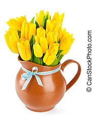 yellow tulips flowers in jug