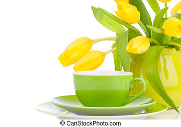 yellow tulips flowers with cup tea, on a white background. ...
