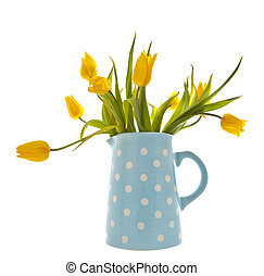 Yellow tulips in a blue spotted jug on white background