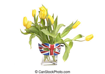 Yellow tulips in a vase with british mask