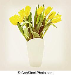 Yellow tulips in vase.