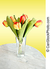Yellow tulips on the table.