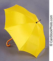 yellow umbrella on a gray background