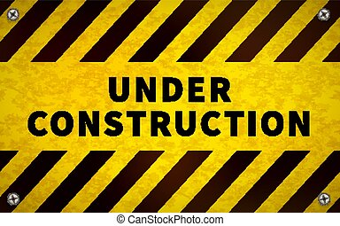 Yellow under construction warning sign with metal screws in corners
