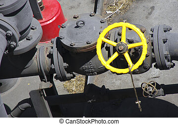 Yellow Valve on Black Pipes