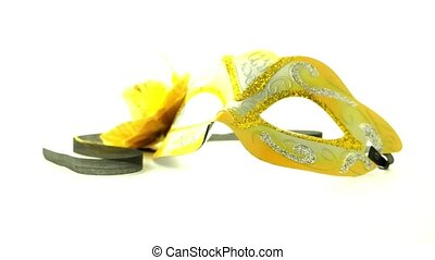Yellow venetian masks for a party on a white background